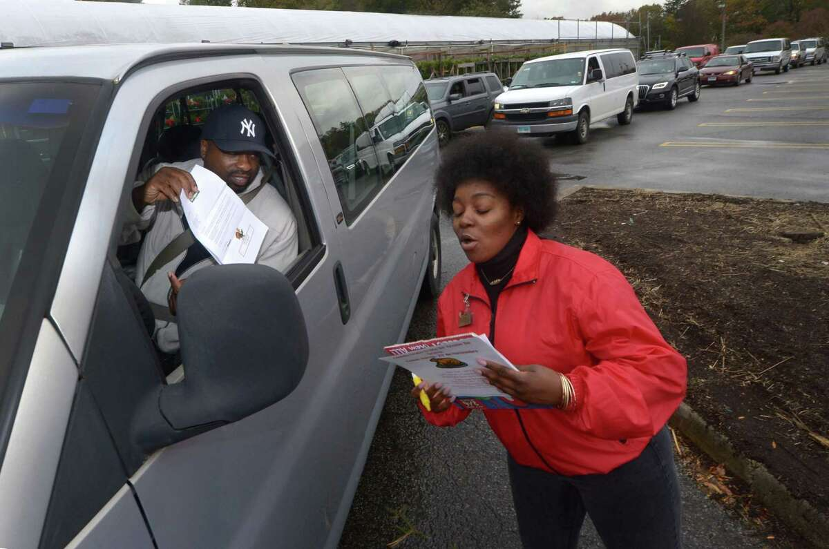 Colley Criss, with the Church for All Nations in Fairfield, checks in to receive free turkeys with Stew Leonards employee Amber Bracey as the store continues its long-standing tradition of giving thanks to the communities it serves with its 38th Annual Turkey Brigade Nov. 16 in Norwalk. The store gave away over 200 frozen turkeys to 33 organizations and over in Norwalk and 2,500 were distributed to more than 100 churches, civic groups, elderly housing and senior nutrition programs, and schools from all their stores in the Norwalk, Newington & Danbury, Connecticut and East Meadow, Farmingdale & Yonkers, New York.