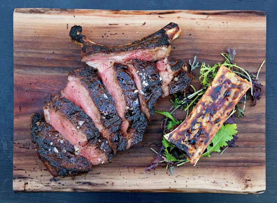 The bone-in, dry-aged steak has reached legendary status at The Durham Hotel in Durham, North Carolina. Photo: Lissa Gotwals Photography / Lissa Gotwals Photography
