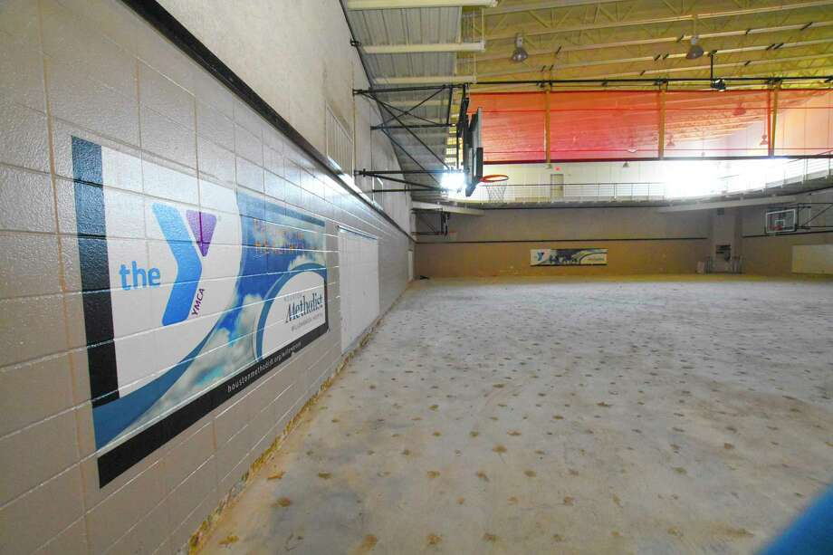 The wood floor of the gym at the D. Bradley McWilliams YMCA at Cypress Creek was warpped after floodwaters rushed in during Hurricane Harvey.  Renovations are under wa with hopes of reopening in June of next year. Photo: Tony Gaines/ HCN, Photographer