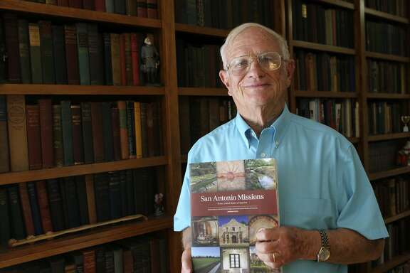 Paul Ringenbach stands by his home library Oct. 23 with his compilation of work on San Antonio's missions. Ringenbach is the lead author of the nomination document for the UNESCO World Heritage Inscription of the San Antonio Missions.