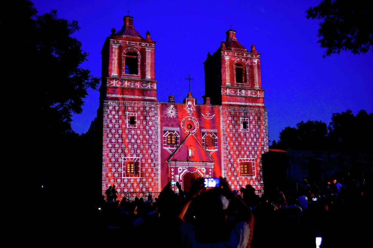 """Mission Concepción is lit to reflect its original 1700s frescoes during the """"Restored by Light """" projection lighting in 2017."""