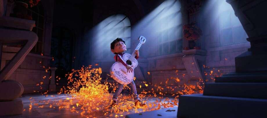 "Miguel (voice of newcomer Anthony Gonzalez) dreams of becoming an accomplished musician like the celebrated Ernesto de la Cruz (voice of Benjamin Bratt) in the Disney Pixar film, ""Coco."" (Pixar) Photo: Pixar, HO / TNS"