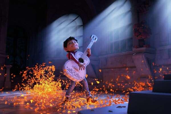 "Miguel (voice of newcomer Anthony Gonzalez) dreams of becoming an accomplished musician like the celebrated Ernesto de la Cruz (voice of Benjamin Bratt) in the Disney Pixar film, ""Coco."" (Pixar)"