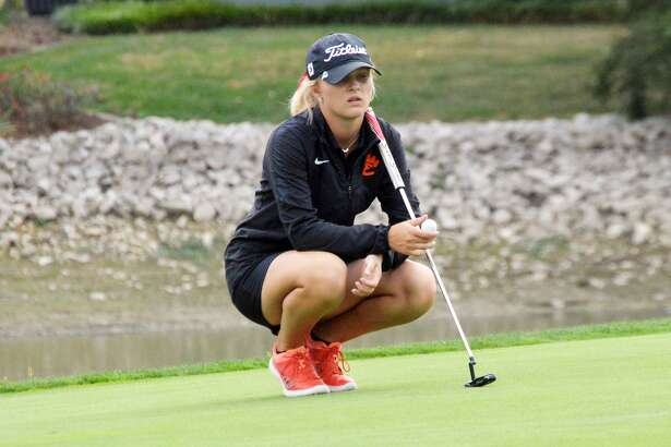 Edwardsville's Addy Zeller surveys the green on the 18th hole at Tamarack Country Club in Shiloh during the Class 2A O'Fallon Regional.