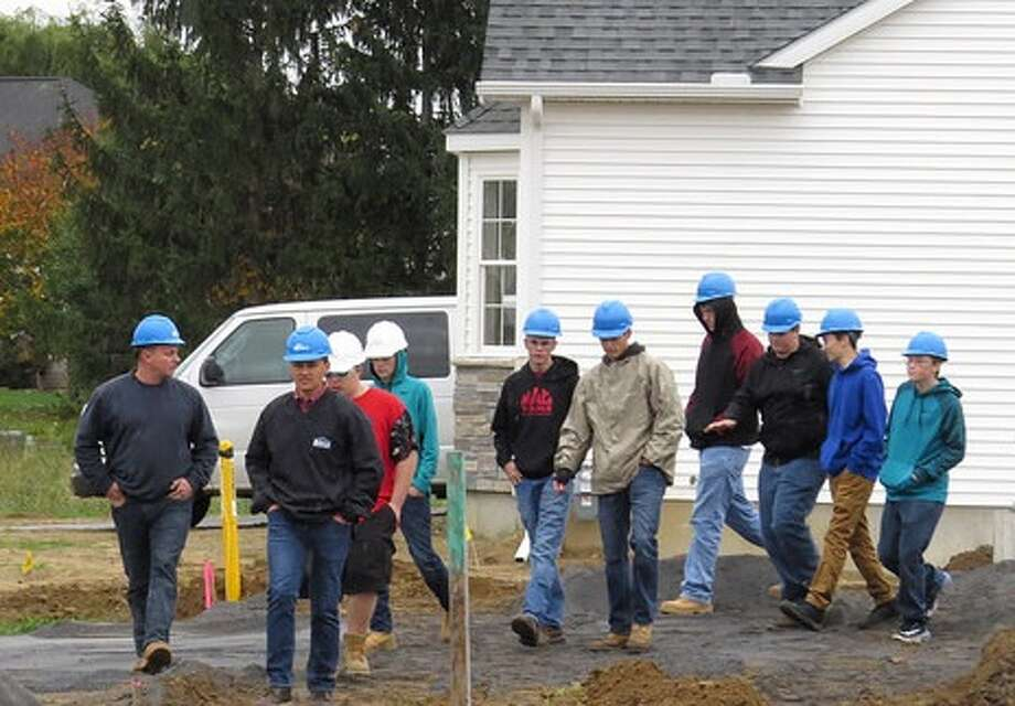 Averill Park High School construction technology students visited the Michaels Group housing development site, Newell Place in the town of Bethlehem on Oct. 26. The students were invited by Eric Willson and Luke Michaels, principals of the Michaels Group, to tour several homes under development and learn more about construction techniques as well as the various stages of construction. Willson is also president of the New York State Builders Association and member of the Capital Region Builders and Remodelers Association.