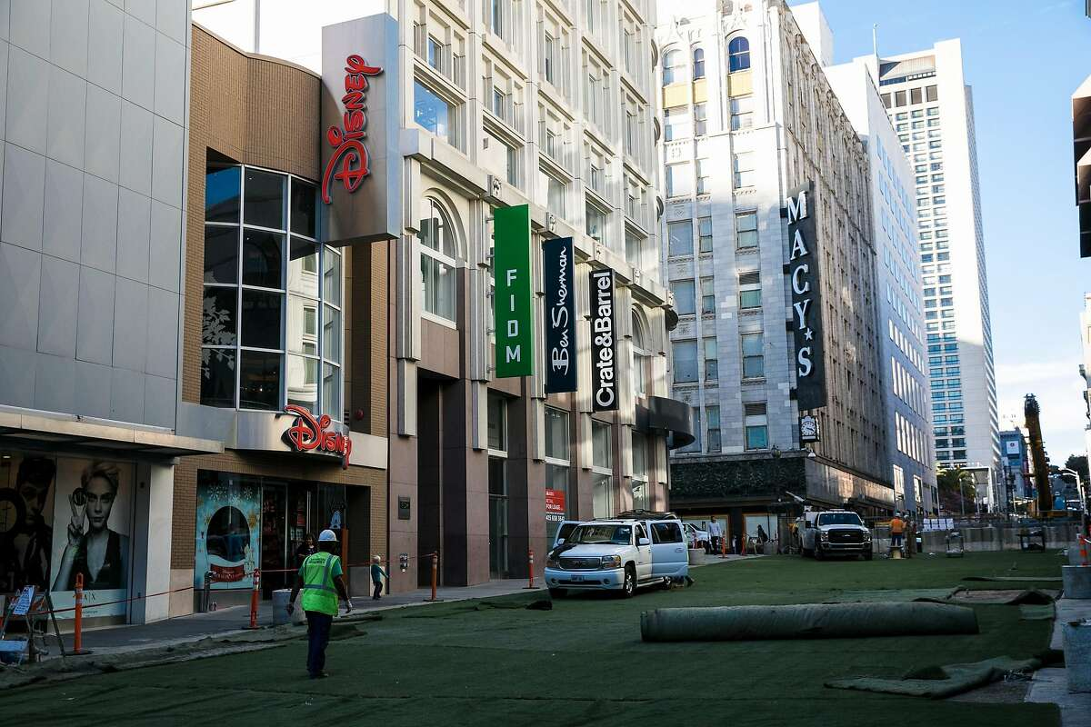 Astroturf is seen at initial stage of installation as construction continues on Stockton Street between Geary Street and Ellis Street where the Winter Walk will be held for holiday shoppers in San Francisco, Calif. Tuesday, November 14, 2017.