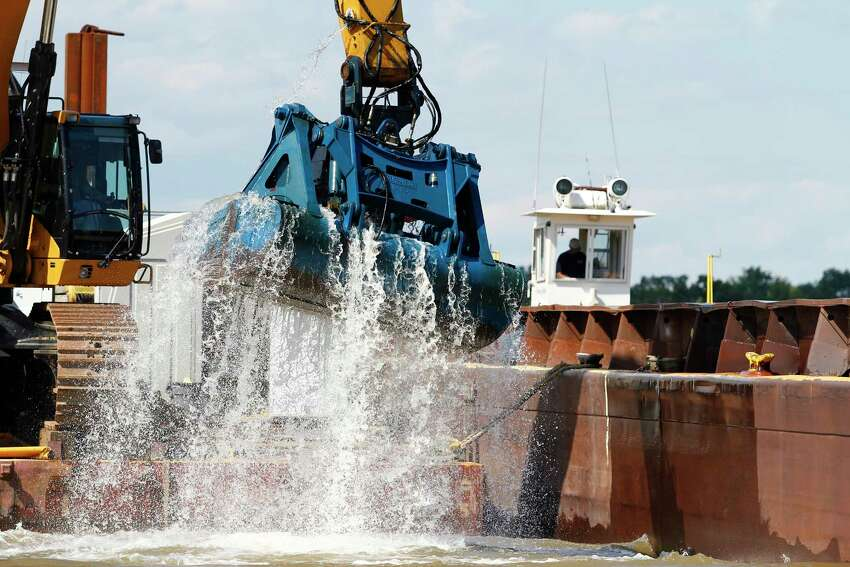 An excavator brings up sediment off of the bed of the Hudson River as part of General Electric's PCB dredging project on Wednesday, Aug. 22, 2012, in Fort Edward, N.Y. (Dan Little/Times Union archive)