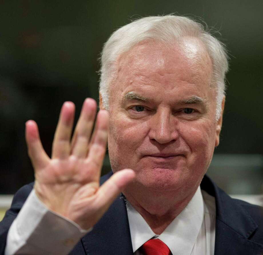 Bosnian Serb military chief Ratko Mladic waves as he enters the Yugoslav War Crimes Tribunal in The Hague, Netherlands, Wednesday, Nov. 22, 2017, to hear the verdict in his genocide trial. Mladic's trial is the last major case for the Netherlands-based tribunal for former Yugoslavia, which was set up in 1993 to prosecute those most responsible for the worst carnage in Europe since World War II. (AP Photo/Peter Dejong, Pool) Photo: Peter Dejong, STF / AP 2017
