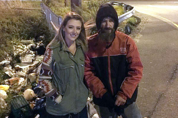 Kate McClure and her benefactor Johnny on an exit ramp of I-95 in Philadelphia.