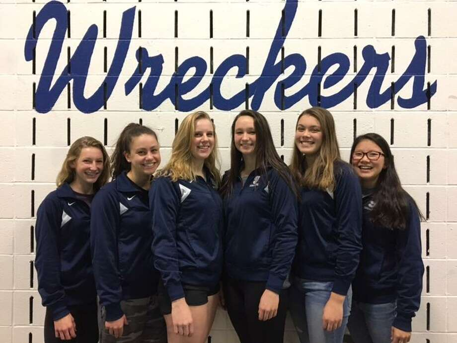 Left, sophomore Annie Bowens, junior Mia Fraas, sophomore Esme Hunter, senior Willow Woods, junior Marissa Healy, and junior Michelle Kennedy of the Staples girls swim team all earned accolades after strong performances during the 2017 season. Photo: Contributed Photo