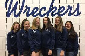 Left, sophomore Annie Bowens, junior Mia Fraas, sophomore Esme Hunter, senior Willow Woods, junior Marissa Healy, and junior Michelle Kennedy of the Staples girls swim team all earned accolades after strong performances during the 2017 season.
