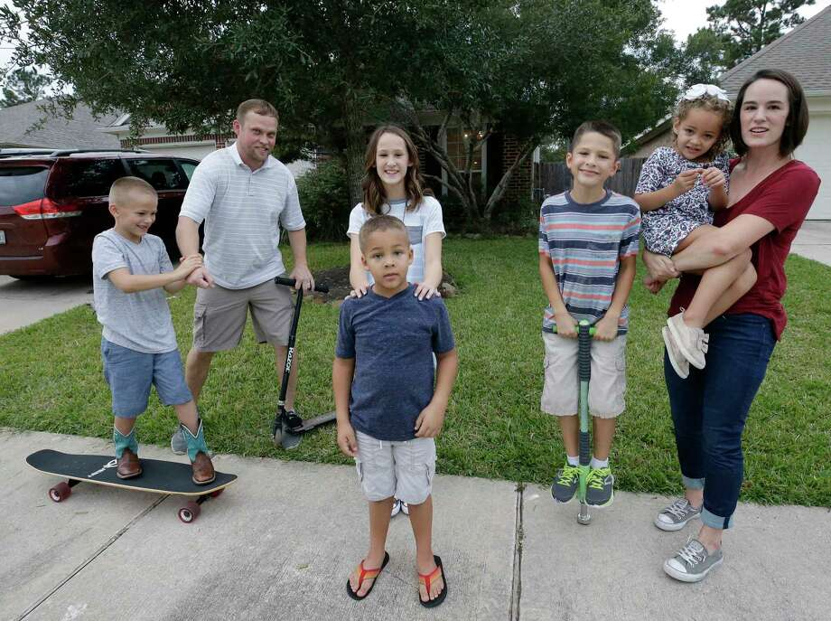 Cliff Conner, second from left, and Stacey Conner with their children, Shepard, 8, left, Grace, 11, Cliff, 6, Isaac, 9, and Kelley, 4, right, as they play outside the home they rent in Spring. Photo: Melissa Phillip, Houston Chronicle / © 2017 Houston Chronicle