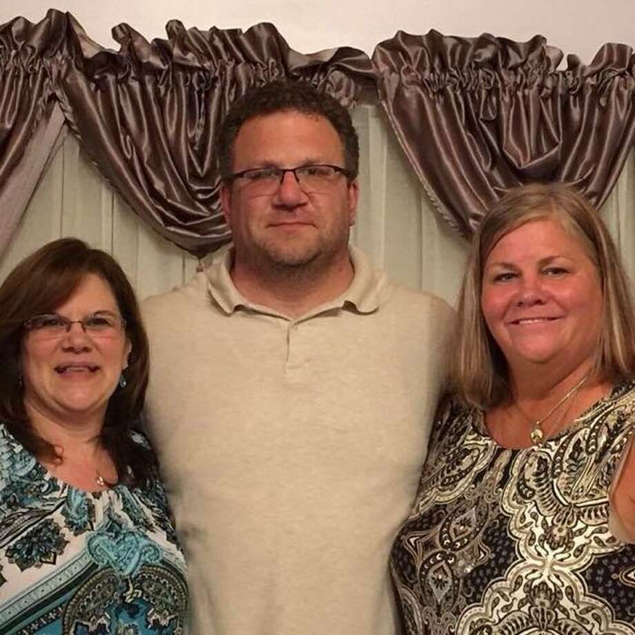 From left, siblings Kim Sampiere, Peter Sampiere and Kathyrn Lesnick Grabowski grew up in Seymour but connected through a DNA test kit Photo: Contributed Photo / Cheryl Sampiere