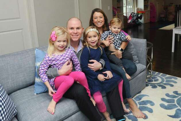 The Jarvis family, from left, Holland, William, Ellie, Jenny and one-year-old pose for a photo inside the playroom of their five-bedroom Shippan home on Ocean Drive West in Stamford, Conn. on Wednesday, Nov. 22, 2017. The Jarvis family is trading their 4,000-square-foot Shippan colonial, which was built in 2010, for a house in Greenwich closer to where their children attend school.