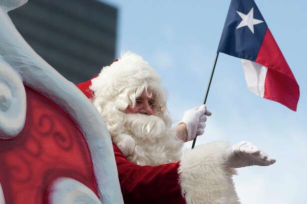 Santa waves to the crowd at the annual H-E-B Holiday parade held in downtown Houston on Thanksgiving morning.  (photo by Patric Schneider)