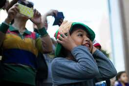 Angel Garcia, 5, covers his ears under the elf ears after the one of the parade floats honks the horn during the 67th Annual HEB Thanksgiving Parade, Thursday, Nov. 24, 2016, in Houston. ( Marie D. De Jesus / Houston Chronicle )