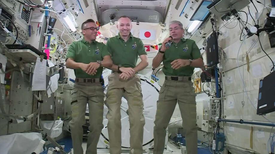 NASA astronauts Joe Acaba, left, Randy Bresnik, center, and Mark Vande Hei plan to feast on pouches of turkey and sides on the International Space Station on Thursday. Photo: HOGP / NASA