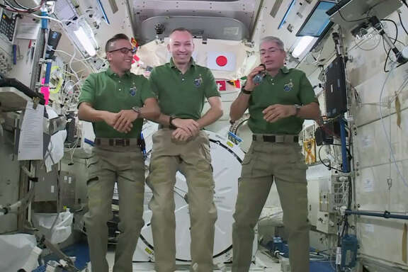 NASA astronauts Joe Acaba, left, Randy Bresnik, center, and Mark Vande Hei plan to feast on pouches of turkey and sides on the International Space Station on Thursday.
