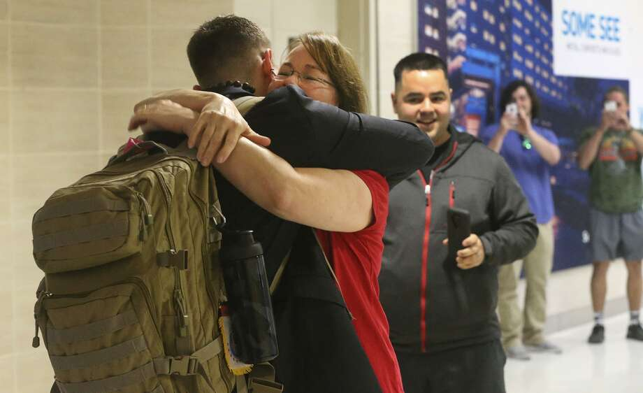 Barbara Sosa hugs her son Michael Sosa (facing away with backpack) Wednesday November 22, 2017 at the San Antonio International Airport as he returns home after two years of missionary work in the midwest United States. Wednesday was a busy day at the airport with travelers heading in and out of San Antonio for the Thanksgiving holiday. Photo: John Davenport, STAFF / San Antonio Express-News / ©John Davenport/San Antonio Express-News