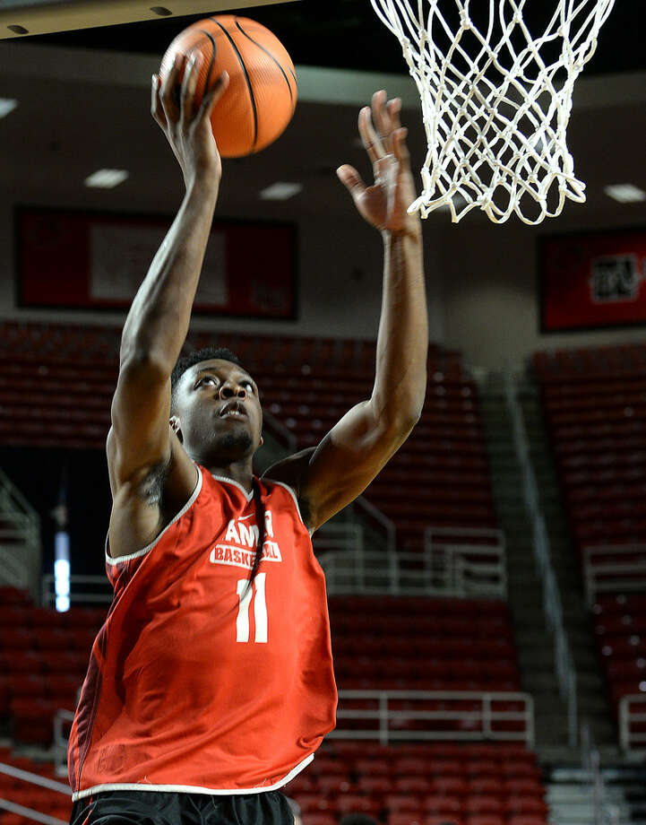 Lamar's Josh Nzeakor gets in shooting practice with teammates Tuesday. The 6-foot-8, Nzeakor is the Cardinal's strongest option in the post. Photo taken Tuesday, November 21, 2017 Kim Brent/The Enterprise