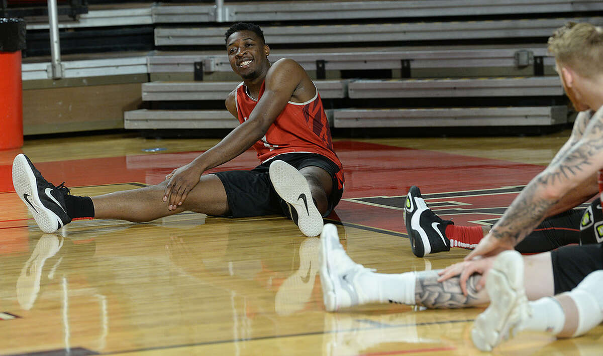 Lamar's Josh Nzeakor jokes with teammates as they warm up beforempractice Tuesday. The 6-foot-8, Nzeakor is the Cardinal's strongest option in the post. Photo taken Tuesday, November 21, 2017 Kim Brent/The Enterprise