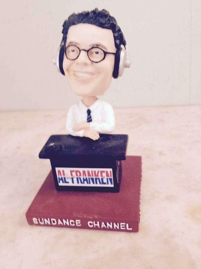 Al Franken bobble head Photo: Randall Beach / Hearst Connecticut Media
