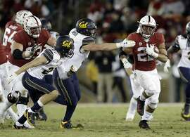 Stanford running back Cameron Scarlett, right, runs against California during the second half of an NCAA college football game Saturday, Nov. 18, 2017, in Stanford, Calif. Stanford won 17-14. (AP Photo/Marcio Jose Sanchez)