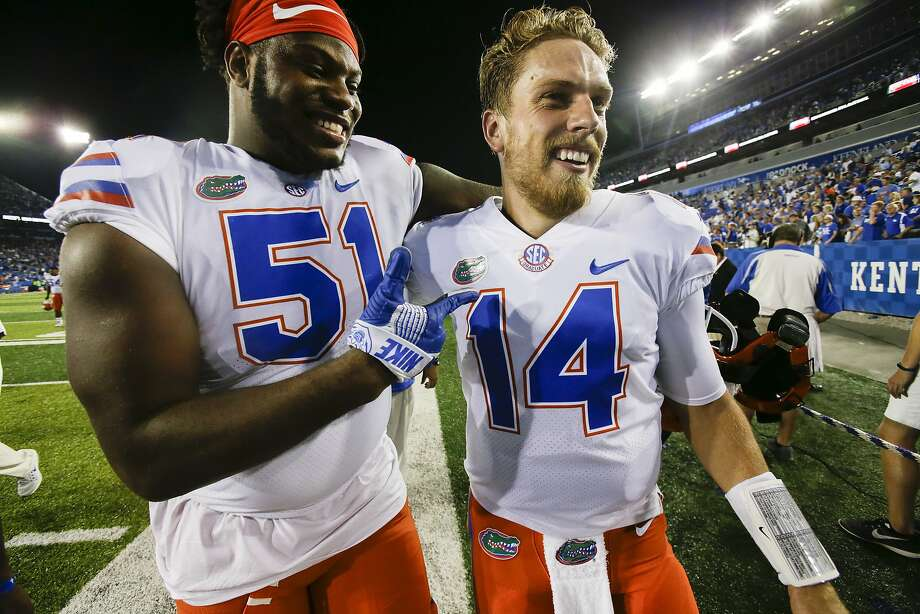 """FILE - In this Sept. 23, 2017, file photo, Florida offensive lineman Antonio Riles, left, celebrates with quarterback Luke Del Rio after an NCAA college football game against Kentucky in Lexington, Ky. Injured Florida quarterback Luke Del Rio has decided to end his """"unique"""" college career. Del Rio posted on his Twitter page Wednesday, Nov. 22, 2017, that he will be participating in """"Senior Day"""" activities before the team's season finale Saturday against rival Florida State. (AP Photo/David Stephenson, File) Photo: David Stephenson, Associated Press"""