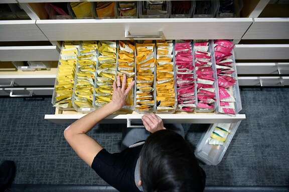 Patient consultant Melissa Zoppa restocks drawers with edible cannabis products at medical cannabis dispensary The Apothecarium in San Francisco, CA, on Wednesday November 22, 2017.