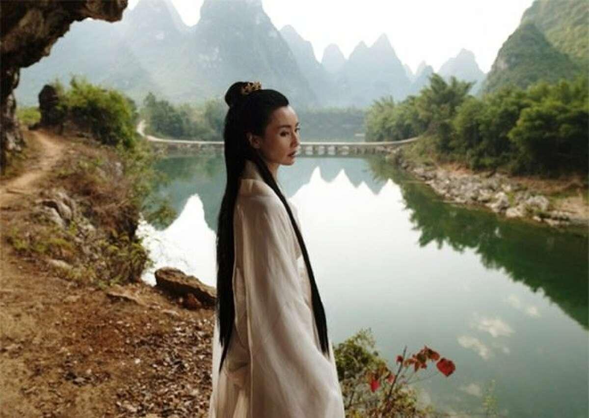 "Legendary Chinese actress Maggie Cheung plays the goddess Mazu in British artist Isaac Julien's multimedia film installation ""Ten Thousand Waves."""