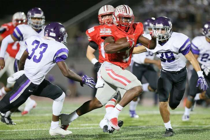 Judson's Sincere McCormick slices through the Warren defense on a 48-yard touchdown run during a 55-14 Class 6A Division I bidistrict victory at Rutledge Stadium on Nov. 17, 2017.