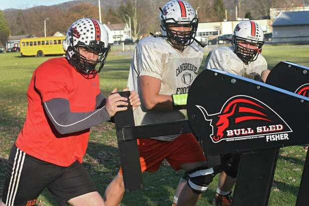 Cambridge starting defensive line, from left, Colton Dean, Nathan Genevick and Keenan McCauley on Tuesday, Nov. 21, 2017 in Cambridge, N.Y. (Lori Van Buren / Times Union)
