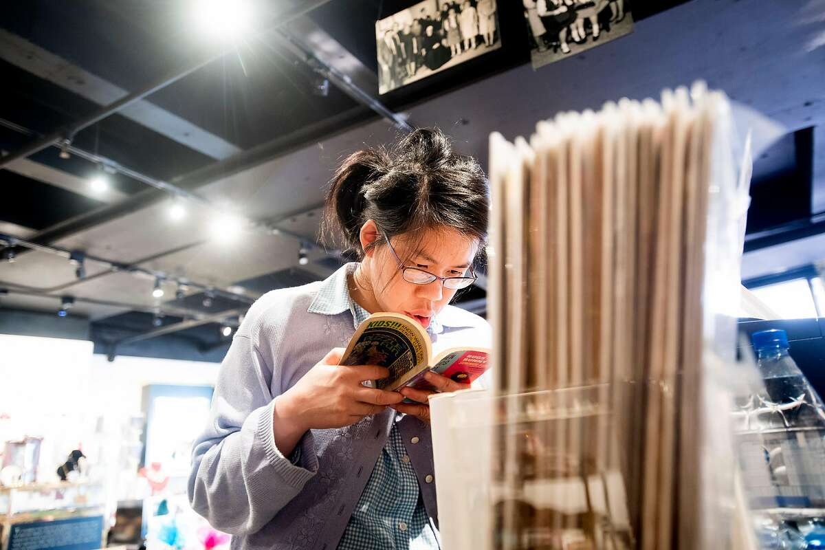 Connie Chu, a client at The Arc San Francisco, reads a comic book while working at Helpers Bazaar on Wednesday, Nov. 22, 2017, in San Francisco.