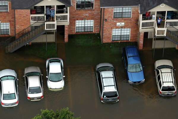 Thousands of cars in the area, like these at a Houston apartment complex, were swamped by floodwaters from Hurricane Harvey.