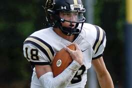 FILE PHOTO: Joel Barlow quarterback Trevor Furrer carries the ball against Notre Dame in a South West Conference varsity football game at Notre Dame Catholic High School on Saturday, Sept. 9, 2017 in Fairfield, Connecticut. Barlow defeated Notre Dame-Fairfield 32-27.