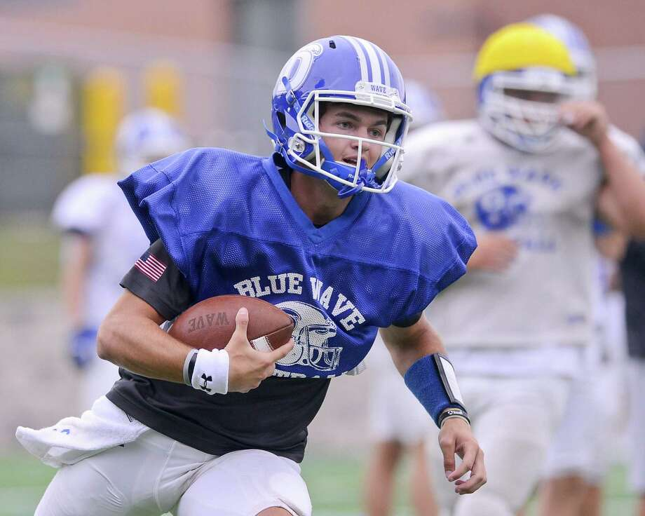 Darien quarterback Jack Joyce carries the ball during a team practice at Darien High School in Darein, Connecticut on Wednesday, Sept. 6, 2017. Photo: Matthew Brown / Hearst Connecticut Media / Stamford Advocate