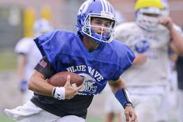 Darien quarterback Jack Joyce carries the ball during a team practice at Darien High School in Darein, Connecticut on Wednesday, Sept. 6, 2017.