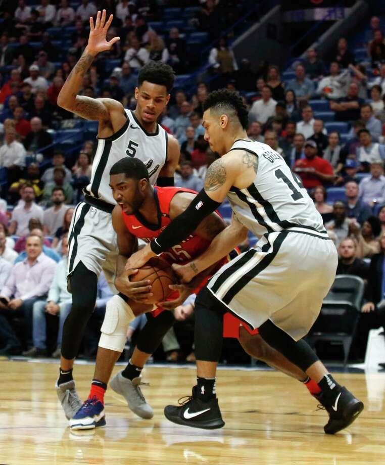 San Antonio Spurs guard Danny Green (14) steals the ball from New Orleans Pelicans forward E'Twaun Moore (55) as guard Dejounte Murray (5) defends in the first half of an NBA basketball game in New Orleans, Wednesday, April 11, 2018. (AP Photo/Scott Threlkeld) Photo: Scott Threlkeld, Associated Press / FR171144 AP