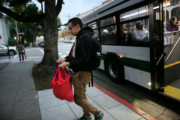 Esteban Vasquez, UC Berkeley senior, disembarks from a bus to carry his groceries home on Wednesday, November 15,  2017 in Berkley, Calif.