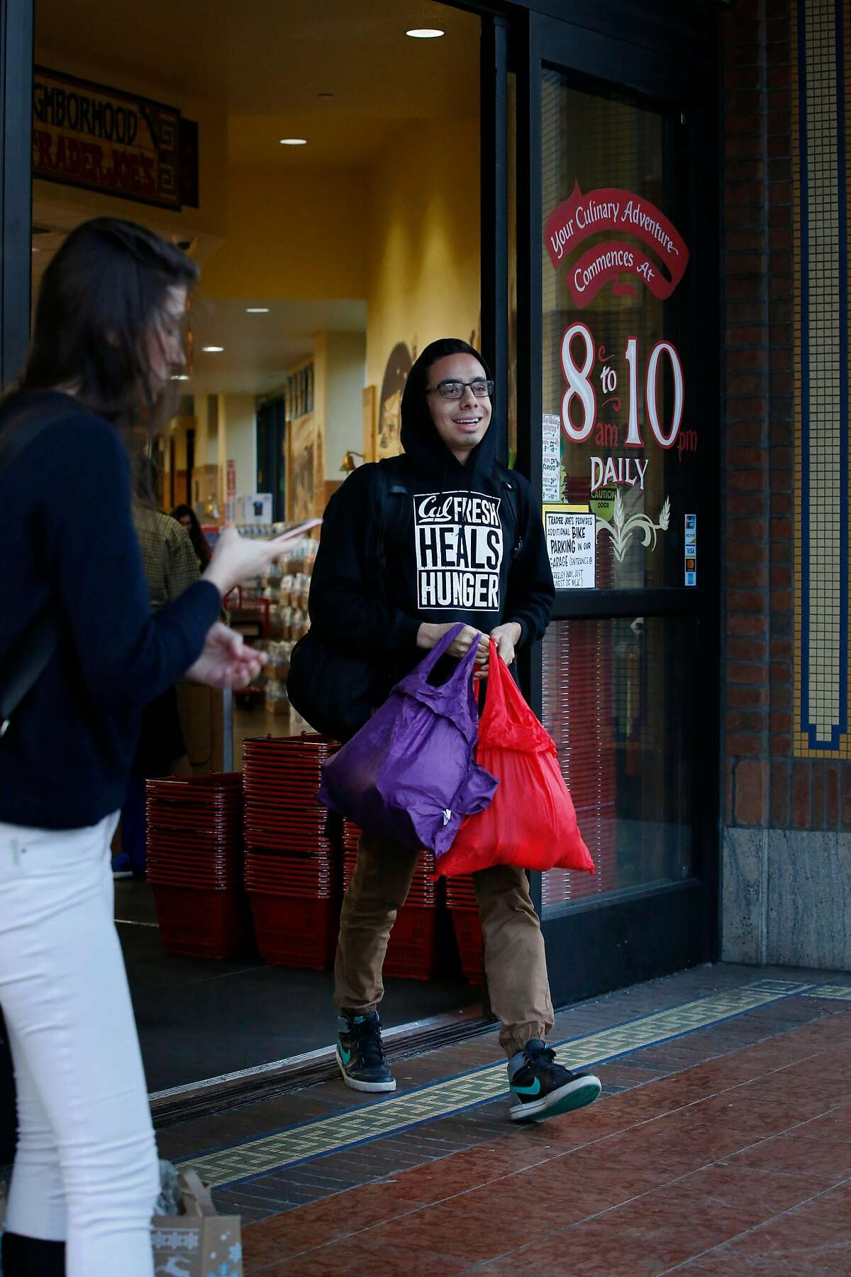 Esteban Vasquez, UC Berkeley senior, carries groceries from a market after shopping on Wednesday, November 15, 2017 in Berkley, Calif. Vasquez is able to use CalFresh to buy some of his groceries.