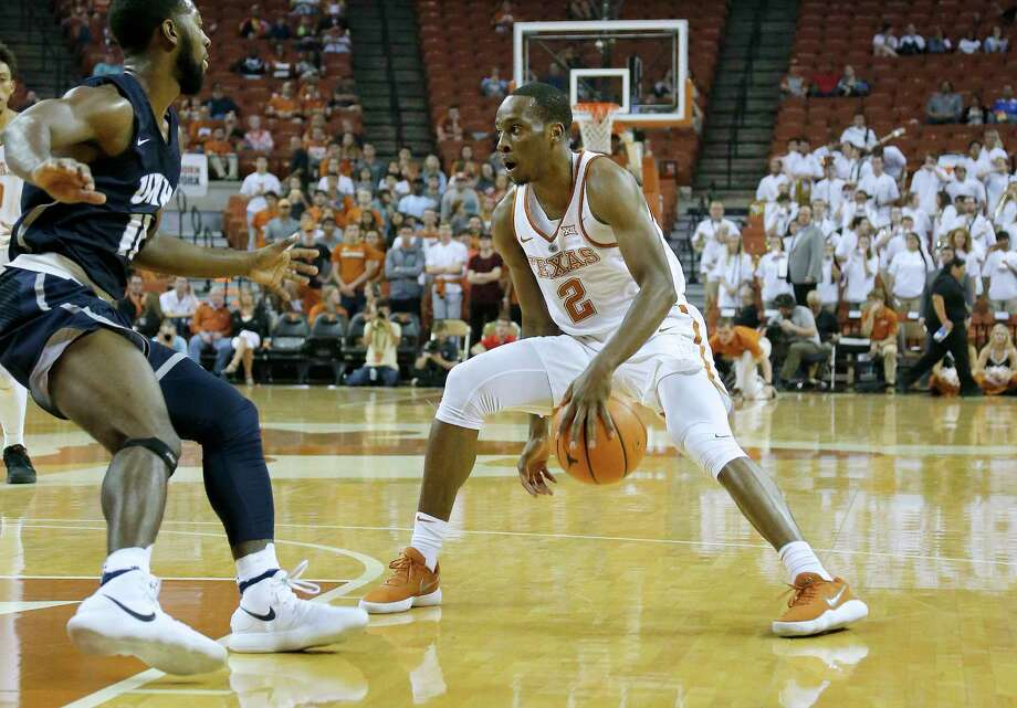 Freshman guard Matt Coleman, right, and the rest of the Longhorns will get a chance to measure themselves against Butler today and No. 1 Duke if they win. Photo: Chris Covatta, Stringer / 2017 Getty Images