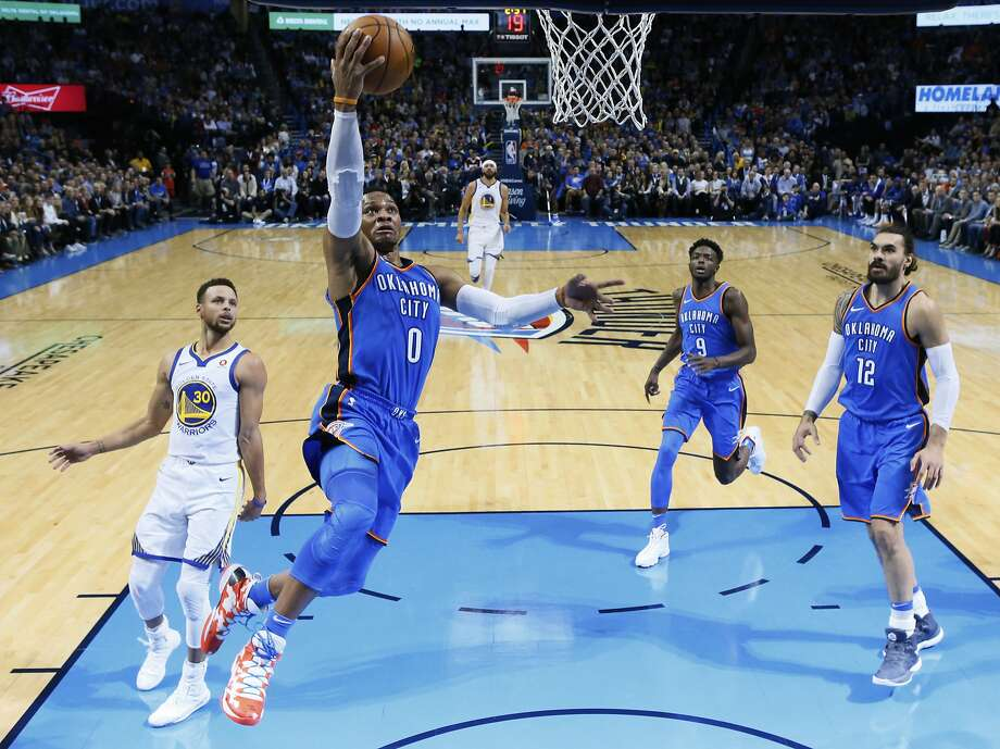 Oklahoma City Thunder guard Russell Westbrook (0) goes up for a shot in front of Golden State Warriors guard Stephen Curry (30) and Thunders' Jerami Grant (9) and Steven Adams (12) during the first quarter of an NBA basketball game in Oklahoma City, Wednesday, Nov. 22, 2017. (AP Photo/Sue Ogrocki) Photo: Sue Ogrocki, Associated Press