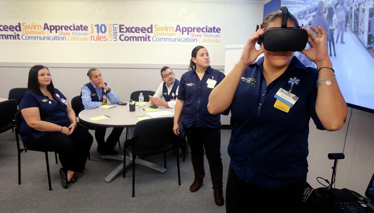 Walmart employee Isabel Reyes experiences a Black Friday virtual reality scenario.