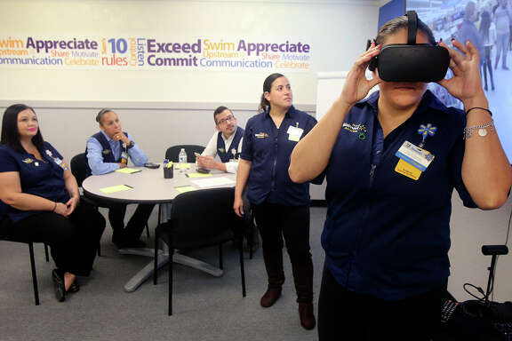 Walmart employee  Isabel Reyes experiences a Black Friday virtual reality scenario.