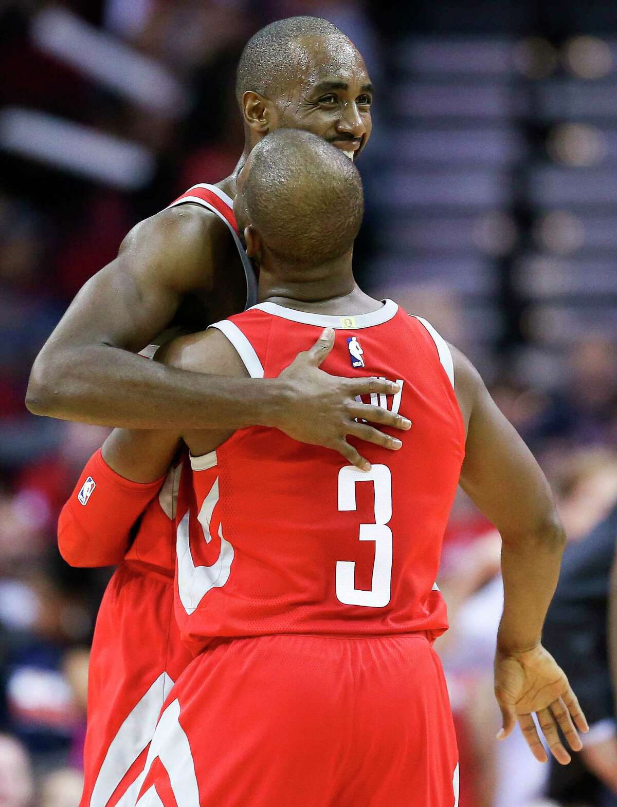 Houston Rockets forward Luc Mbah a Moute, top, hugs Chris Paul during a timeout during the second half of an NBA basketball game against the Denver Nuggets, Wednesday, Nov. 22, 2017, in Houston. Houston won the game 125-95. (AP Photo/Eric Christian Smith)