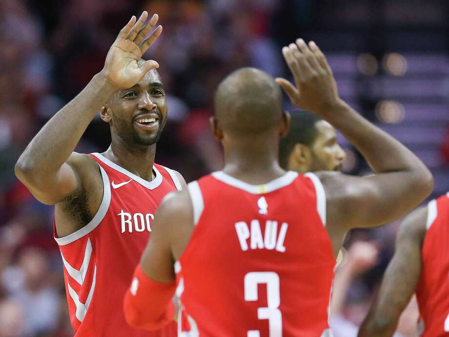 Houston Rockets forward Luc Mbah a Moute, left, celebrates with Chris Paul during a timeout during the second half of an NBA basketball game against the Denver Nuggets, Wednesday, Nov. 22, 2017, in Houston. Houston won the game 125-95. (AP Photo/Eric Christian Smith) Photo: Eric Christian Smith, Associated Press / FR171023 AP