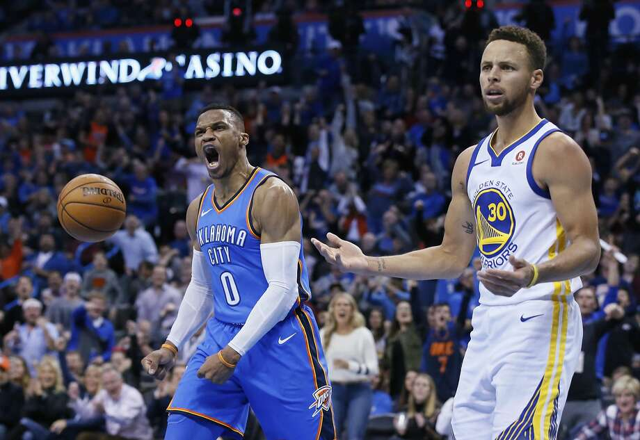 Oklahoma City Thunder guard Russell Westbrook (0) and Golden State Warriors guard Stephen Curry (30) react after Curry was called for a foul on Westbrook during the third quarter of an NBA basketball game in Oklahoma City, Wednesday, Nov. 22, 2017. (AP Photo/Sue Ogrocki) Photo: Sue Ogrocki, Associated Press