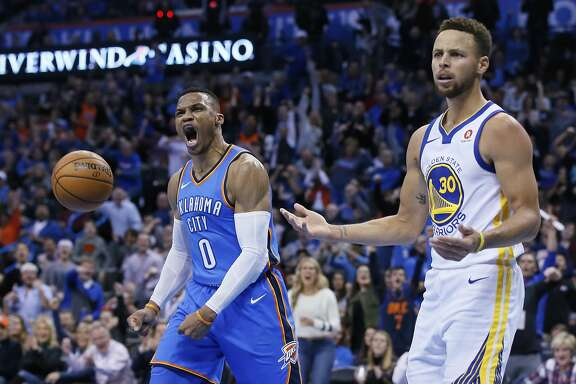 Oklahoma City Thunder guard Russell Westbrook (0) and Golden State Warriors guard Stephen Curry (30) react after Curry was called for a foul on Westbrook during the third quarter of an NBA basketball game in Oklahoma City, Wednesday, Nov. 22, 2017. (AP Photo/Sue Ogrocki)