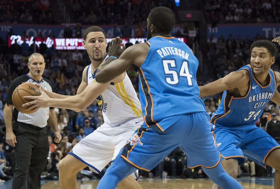 Patrick Patterson forces Klay Thompson to pass the ball during the second half at Chesapeake Energy Arena on November 22, 2017. Photo: J Pat Carter, Getty Images