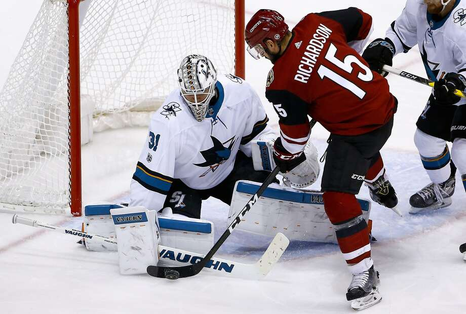 Sharks goalie Martin Jones stymies Coyotes center Brad Richardson from close range in the second period of San Jose's 3-1 victory in Glendale, Ariz. Jones stopped 26 shots for his ninth win of the season. Photo: Ross D. Franklin, Associated Press